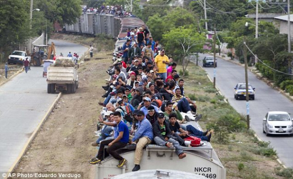 "Central American migrants on the train known as ""The Beast."""