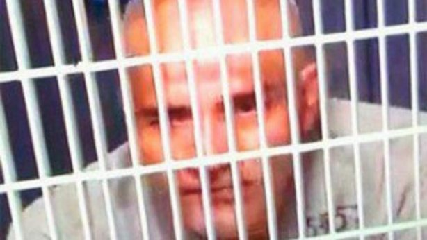 José Manuel Mireles behind bars with head shaved