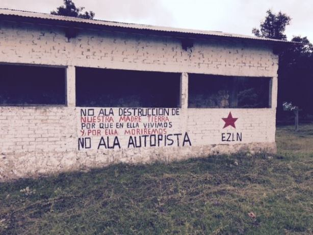 """No to the Super-Highway,"" painted on a building in Los Llanos Ejido."