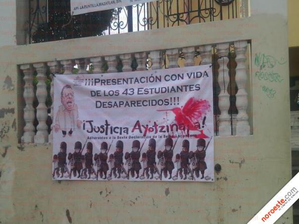 Banner by Adherents to the EZLN's Sixth Declaration demanding that the 43 disappeared Ayotzinapa students be returned alive!