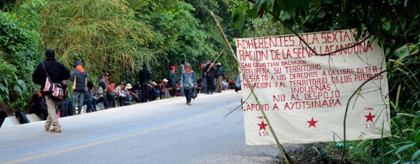The banner begin with: Adherents to the Sixth Declaration of the Lacandón Jungle