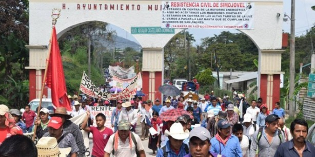 """The banner hung on the entrance to the town says: """"resistencia civil"""" or civilian resistance."""