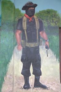 Subcomandante Moisés holding his radio in a La Realidad Mural