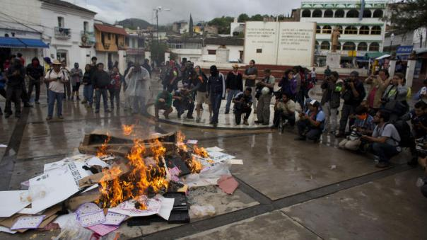 People burned ballots in Tixtla, Guerrero (above) and in other states prior to Mexico's midterm elections last Sunday, June 7. The PRI benefitted from the decline of the PRD.