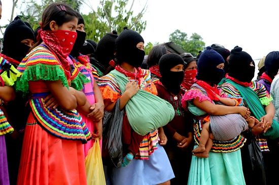 Zapatista youth and women form much of the current support base of the rebel organization.  They were in La Realidad during an homage to fallen compañero - Galeano - killed in a paramilitary attack against Zapatista members in La Realidad on May 2, 2014.  Thousands gathered in La Realidad to show there digna rabia, dignified rage, demand justice and an end to the on-going violence directed towards Zapatista indigenous communities in Chiapas.  The May 2nd attack was the first such attack directly in a Zapatista Caracol - Cultural Center of Resistance and Autonomous Governance.