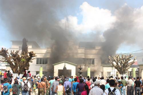 Members of the Tila ejido set country offices on fire.