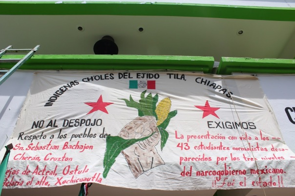 Banner hanging on the facade of the Tila municipal headquarters, now reclaimed and occupied by members of the ejido and adherents to the EZLN's Sixth Declaration.
