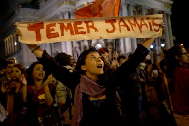 "A Brazilian protester's sign reads: ""Never Temer."""