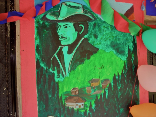 A mural  on the front of the Good Government Junta's offices in La Garrucha includes the image of Francisco Gomez, one of the EZLN's early organizers in this Zone. He dies in the bloody battle of Ocosingo in January 1994.