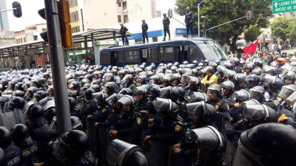 Police confront teachers in Mexico City.
