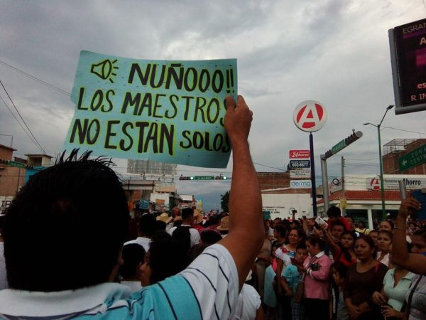 The sign reads Nuño the teachers are not alone