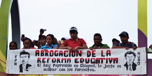 The sign reads: Abrogation of the education reform