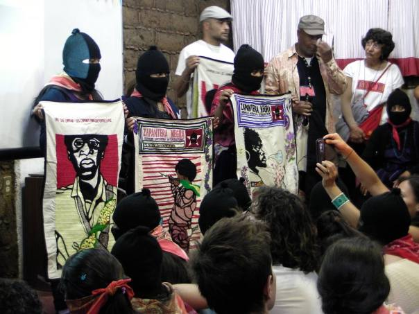 Caleb Duarte and Emory Douglas present the Zapatera Negra textile project at CompARTE in Chiapas.