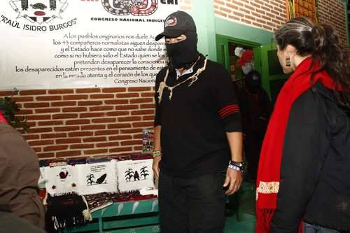 """Galeano walking around at """"The Zapatistas and ConSciences for Humanity."""" It's interesting to note the absence of his military cap and shirt."""