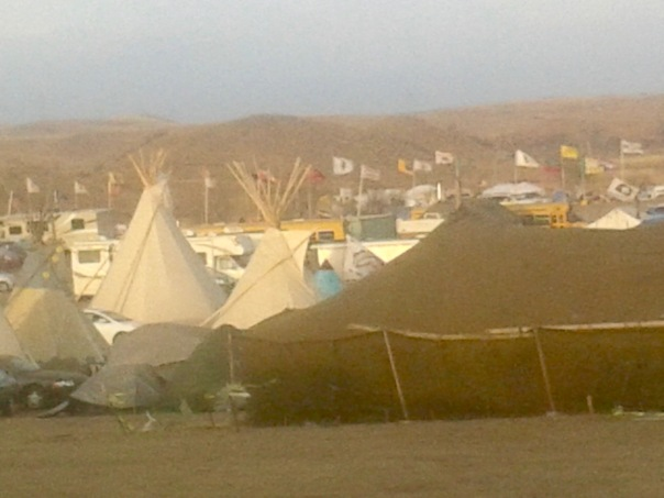Tents and Teepees at Oceti Sakowin (seven council fires) Camp with Flag Road in the background. Photo: Todd Davies, November 22, 2016.